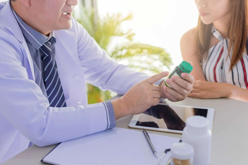doctor Instructive about medical pills to patient. select focus